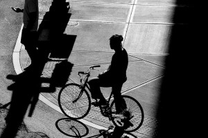 Silhouetted man on bike