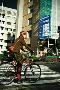Girl on bike on zebra crossing